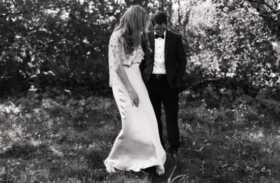 Wedding couple standing in a field in Vermont.